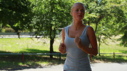 A woman jogs while looking around Footage