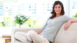 Woman laughing indoors Stock Video Footage