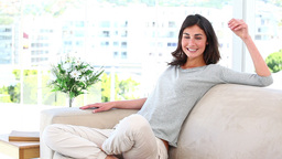 Woman relaxing on couch Footage