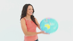 A woman holds a globe in her hand Footage