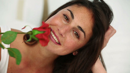 Woman smelling a red rose Footage