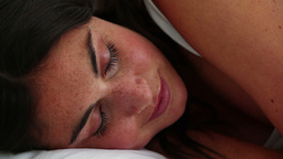 Brunette haired woman sleeping Footage