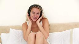 Blonde woman listening to headphones Footage