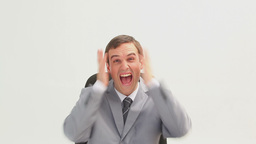 Businessman shouting while sitting on a swivel cha Footage