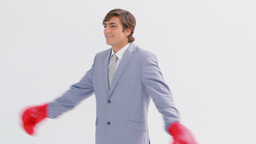 Happy businessman using boxing gloves Footage