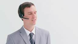 Happy businessman using a headset Footage