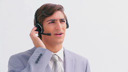 Handsome businessman talking on a headset Live Action