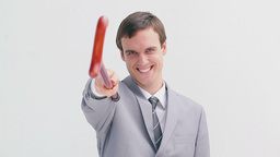Businessman holding a red walking stick Footage