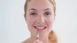 Smiling woman using a lip brush Footage