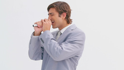 Happy executive singing into a cordless microphone Footage