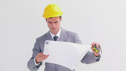 Serious architect reading blueprints Footage