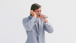 Smiling man singing in a microphone Footage
