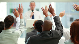 Business people raising their hands together Footage