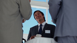 Low angle view of a businessman holding coffee cup Footage