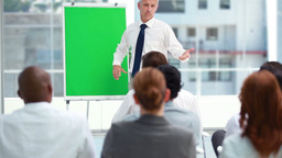 Man showing with the board with his hand Footage