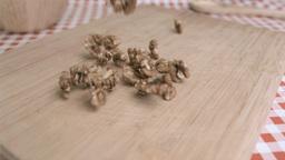 Walnut kernels falling in super slow motion on a w Footage