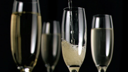 Champagne being poured in super slow motion in flu Footage