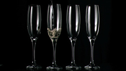 Champagne flowing in super slow motion in flutes Footage