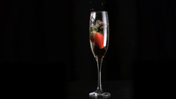 Strawberry diving into water in super slow motion  Footage
