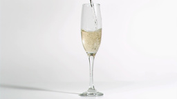 Glass filled in super slow motion with champagne Footage
