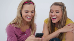 Friends sending a textmessage together Footage