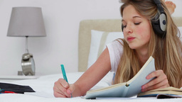 Serious young woman studying with notebooks Footage