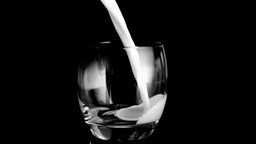 Milk filling a glass in super slow motion a glass Footage