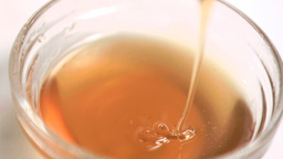 Honey being poured in super slow motion Footage