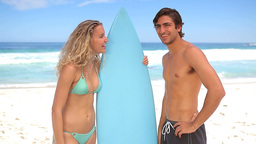 Man flirting with a female surfer Footage
