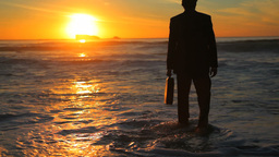 Man in suit walking to the sea Footage