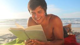 Handsome man reading a novel Live Action