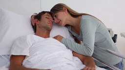 Woman embracing her unconscious husband Live Action