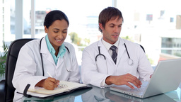 Doctors taking information on internet Footage