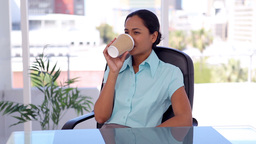 Welldressed woman drinking a coffee Footage
