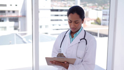Female doctor writing on a file Footage