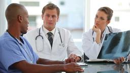 Three doctors talk to a nurse Footage