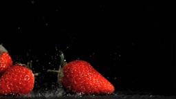 Nice strawberries in super slow motion being wet Footage