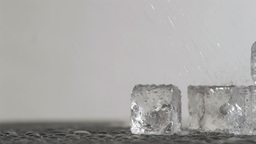 Ice cubes in super slow motion melting Footage