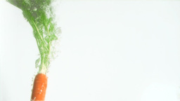 Delicious carrot in super slow motion falling Footage