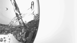Water in super slow motion filling a glass Footage
