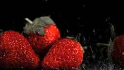 Red strawberries in super slow motion being wet Footage