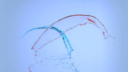 Red and blue splashes in super slow motion Footage