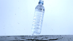 Plastic bottle falling in super slow motion Footage