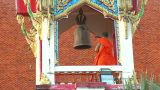 Thai Monk Hit Big Bell In Temple Close stock footage