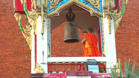 thai monk hit big bell in temple close Footage