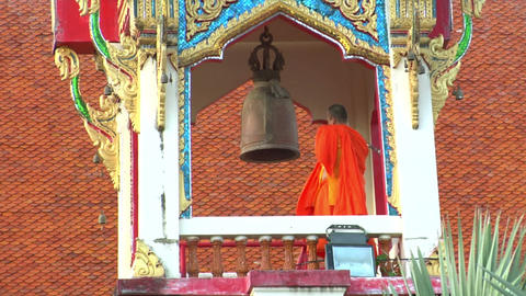 thai monk hit big bell in temple close Stock Video Footage