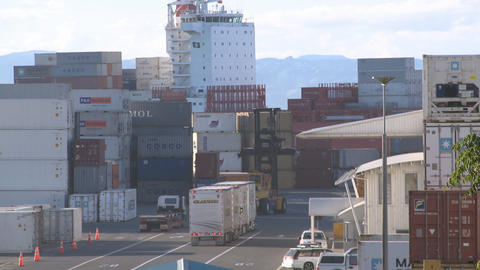 container ship passes behind containers Footage