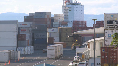 container ship passes behind containers Stock Video Footage