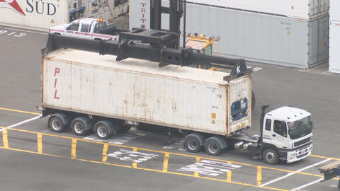 container unload from truck Stock Video Footage