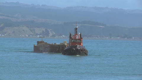 tug pulling barge Stock Video Footage